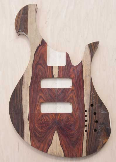 Xylem custom bass guitar with cocobolo top