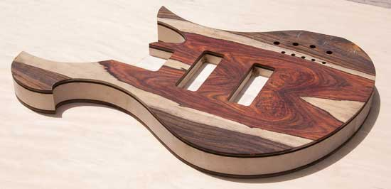 Custom bass with maple body, cocobolo, ebony tops