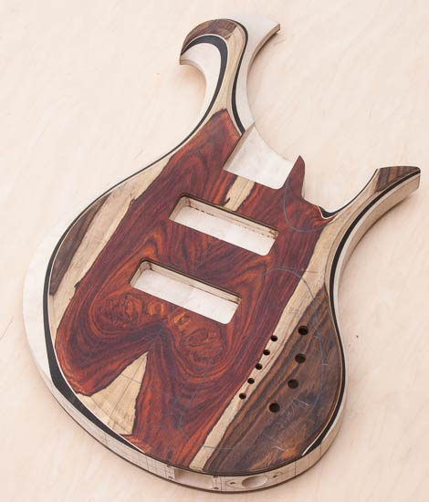 Custom bass guitar with carved Xylem-style scroll