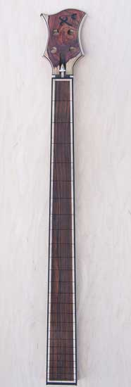 Custom bass neck with cocobolo fretboard, maple, ebony borders