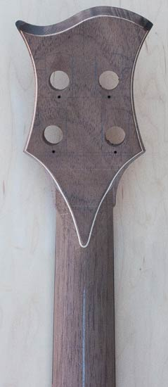 Volute of a four-string custom bass neck with Peruvian walnut veneer