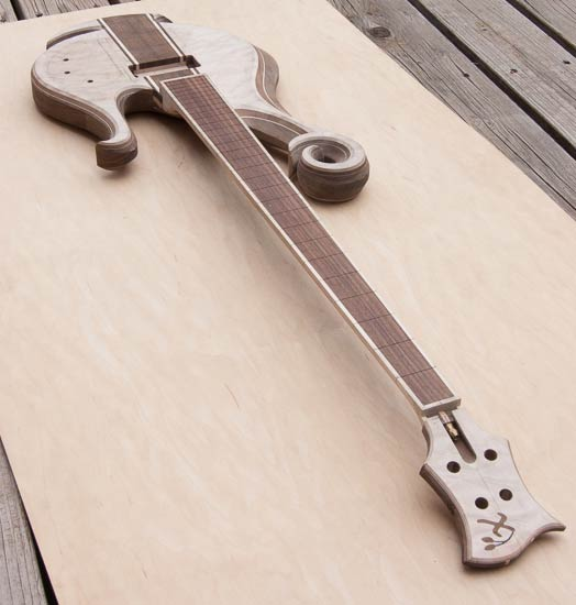 Short-scale custom bass guitar with hook scroll
