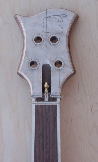 Quilted maple headstock of a custom bass