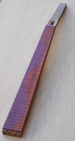 Spliced purplheart and bloodwood fretboard on a goncalo alves neck blank