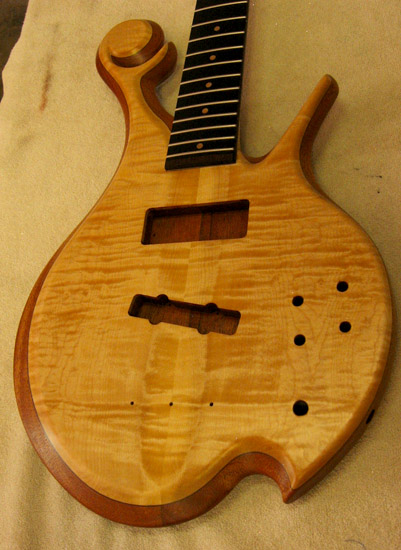Curly maple top on a Xylem custom bass
