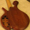 Back of a custom 5 string bass with mahogany body