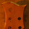 Back of a 5 string bass guitar headstock with mahogany veneer