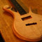 Flamed maple top on a 5 string custom bass