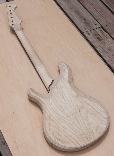 Swamp ash electric guitar with Knaggs body shape